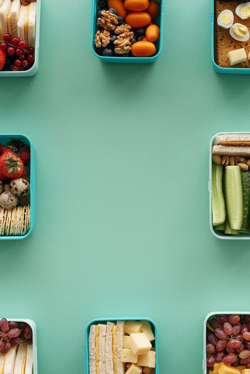 Brown and Green Food Container on White Table