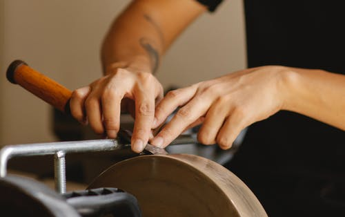 Crop master grinding chisel in workshop