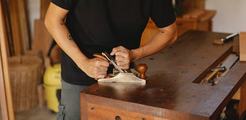 Crop master cutting wooden plank