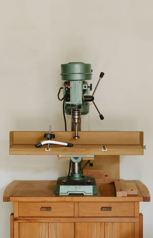 Drilling machine on wooden table