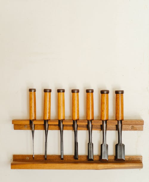 Collection of various chisels on wall