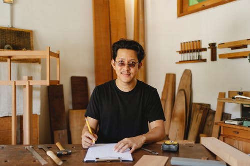 Charismatic Asian man in modern workshop