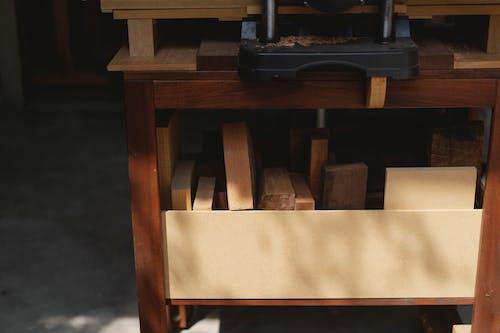 Planer and assorted wooden blocks in workroom