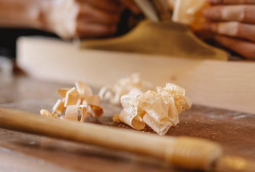 Think shavings of wood on workbench