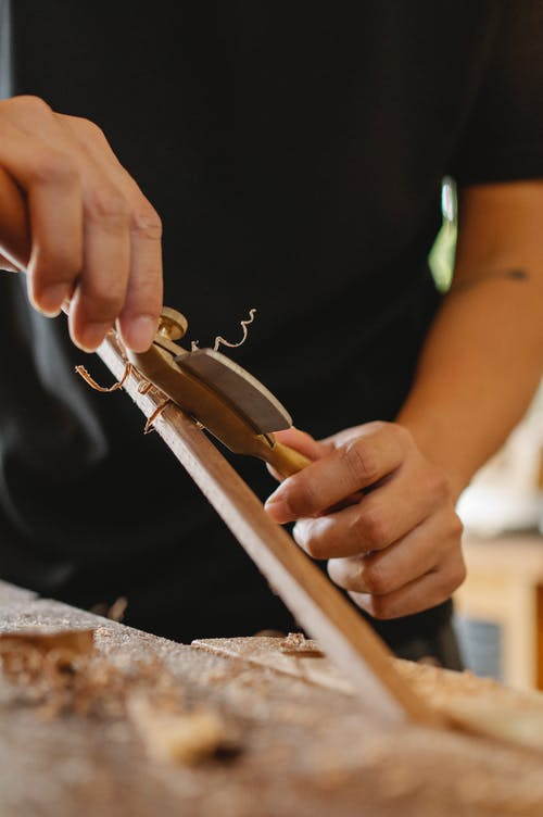 Anonymous woodworker using spokeshave in workshop