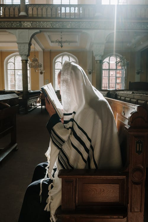 Person in White Hijab Reading Book