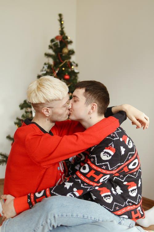 Boy Kissing Womans Cheek