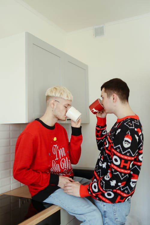 Boy in Red Sweater Drinking from White Ceramic Mug