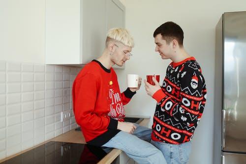 Man in Red Sweater Holding White Ceramic Mug