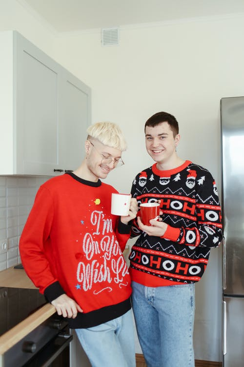 2 Boys in Red Long Sleeve Shirt Standing Beside Refrigerator