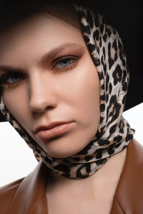 Stylish woman in headscarf with leopard print