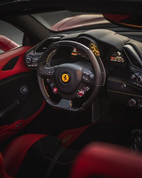 Steering wheel of luxury car in modern interior