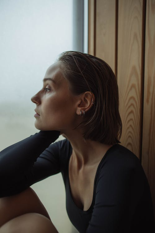 Side Profile of Lonely Woman in Black Long Sleeves