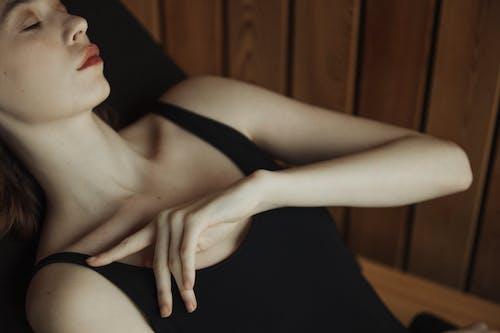 Woman in Black Tank Top Sleeping