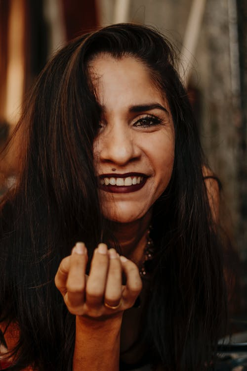 Smiling ethnic woman looking at camera