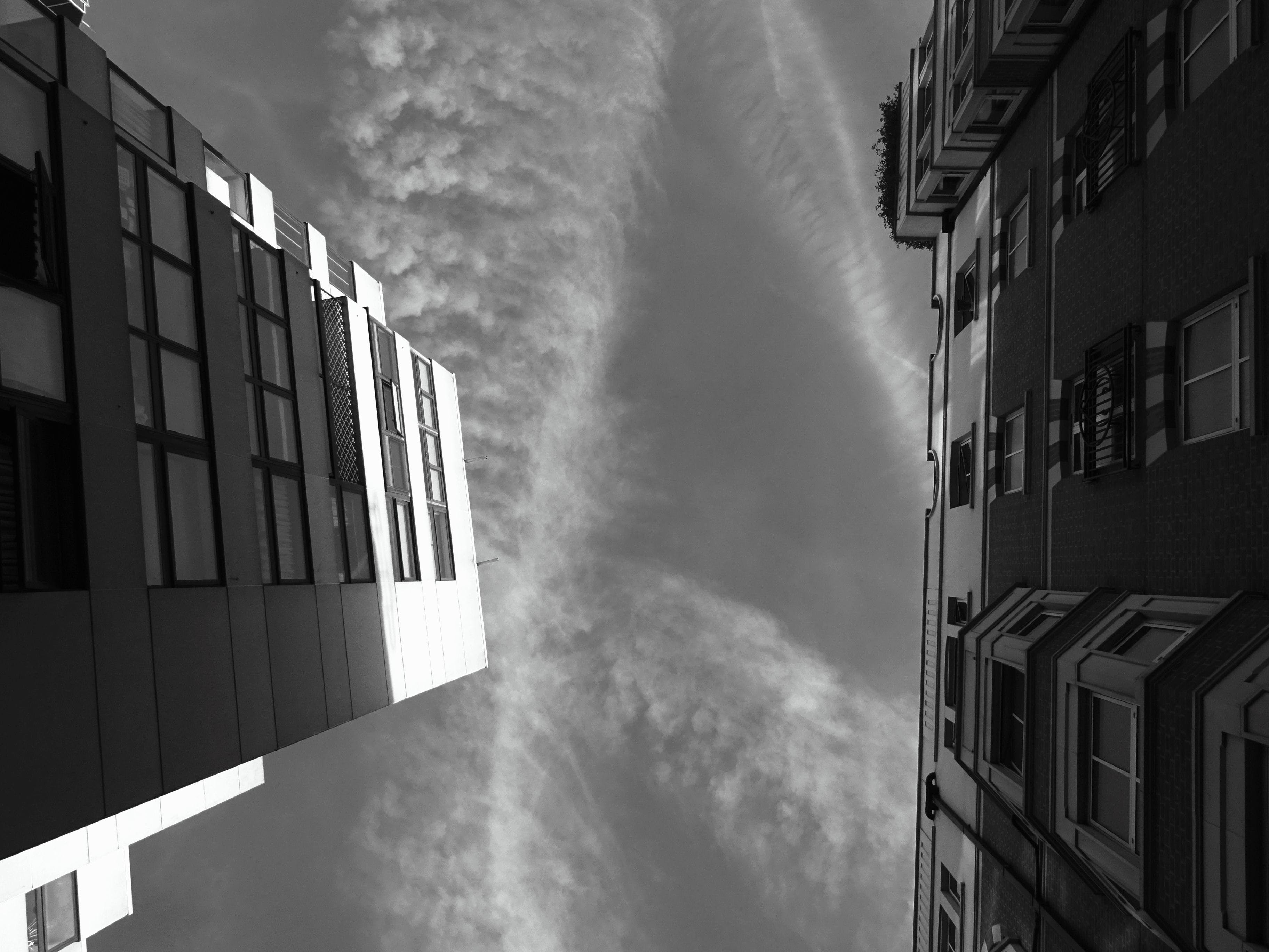 Grayscale Photo of Building's Worm's Eye View