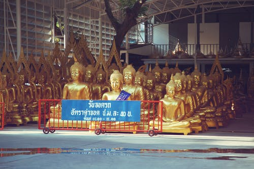 Many golden Buddha statues kept in spacious storehouse
