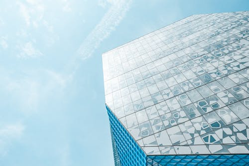 Low-angle Photography of Blue Laminated Glass Building Under Calm Blue Sky