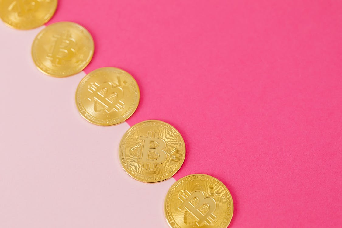 Gold Coins on Pink Surface