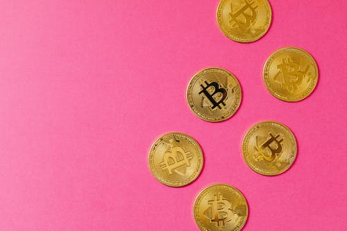 Gold Round Coins on Pink Textile