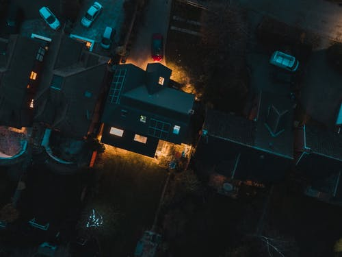 Cars parked near residential houses at night