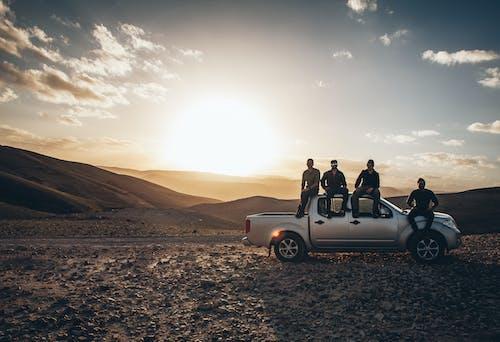 Foto profissional grátis de alvorecer, amanhecer, ao ar livre, areia