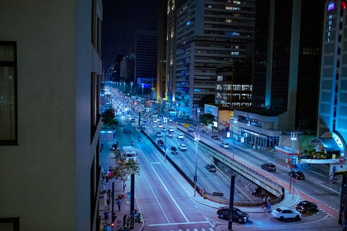 Modern city street with road at night time