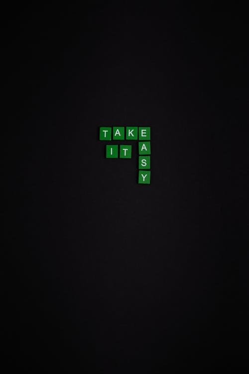 Green and White Text Based Tiles On Black Background