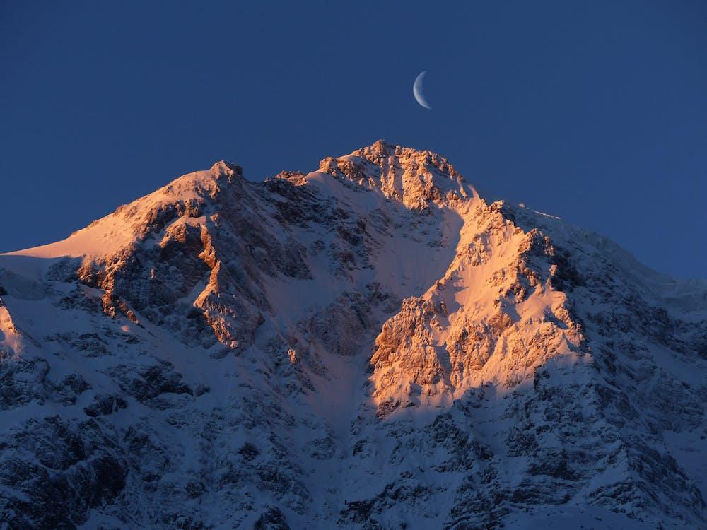 Crescent Moon over Snow Mountain