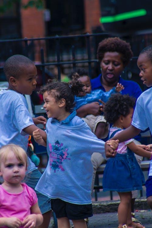 Boy in Blue Crew Neck T-shirt Standing Beside Girl in Blue Crew Neck T-shirt