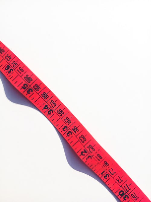 Measuring tape on white surface