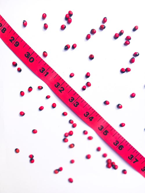 Heap of beans with measuring tape