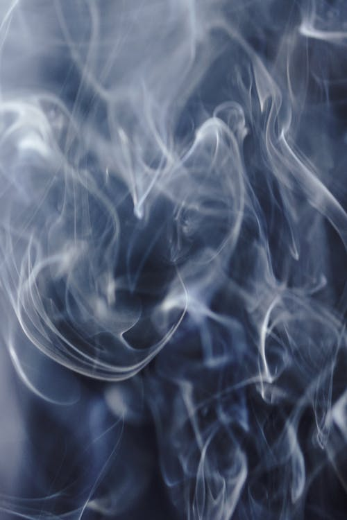Abstract backdrop of dynamic smoke creating waves in air