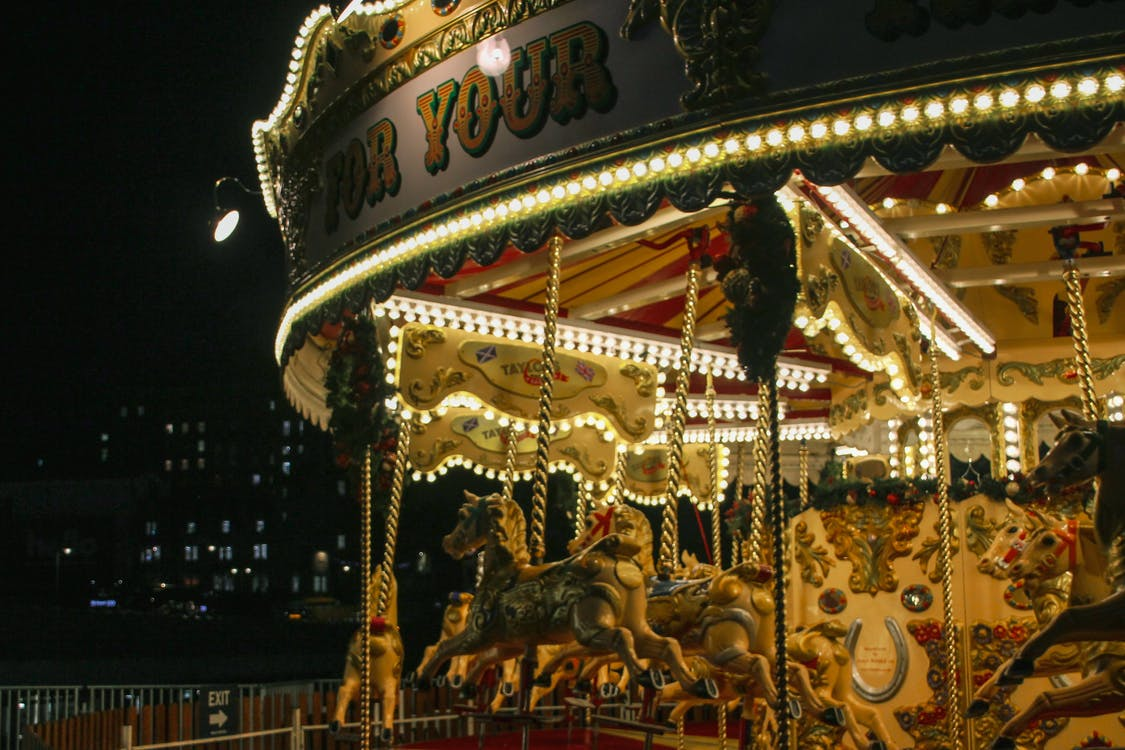 White and Brown Carousel With Horse Carousel