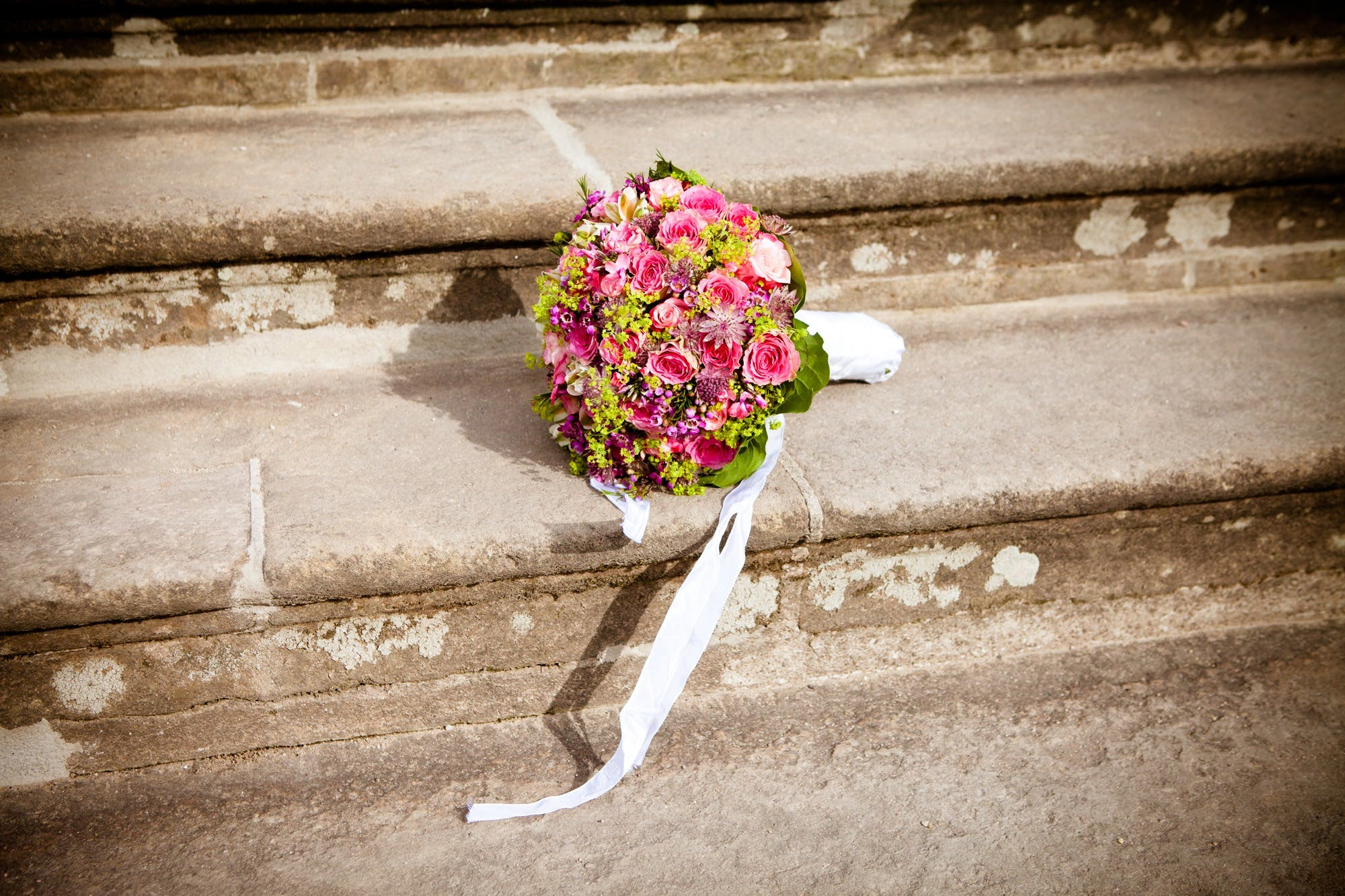 Flower Bouquet on Stairs during Daytime