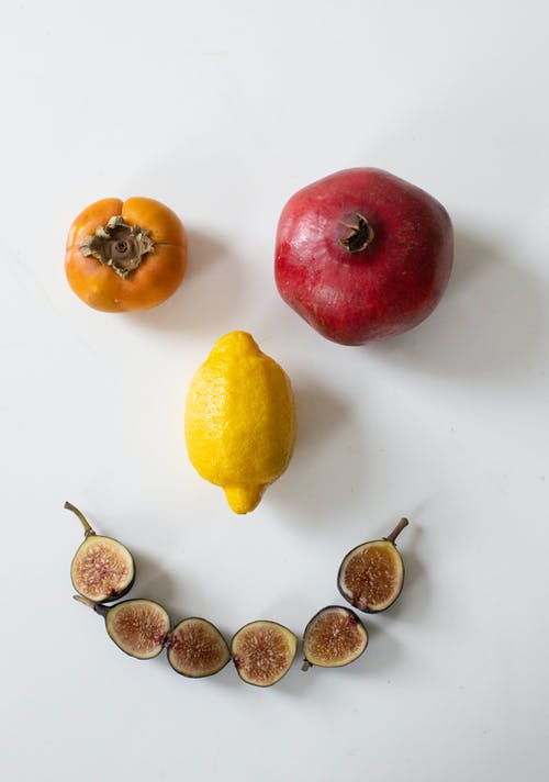 Fresh ripe fruits composed in face on table