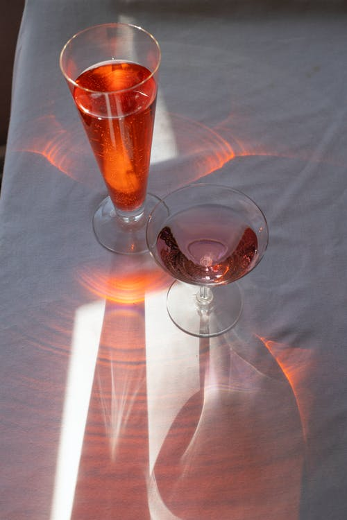 Crystal glasses with beverages on table
