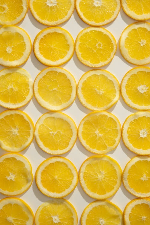 Sliced citrus fruits laid on table