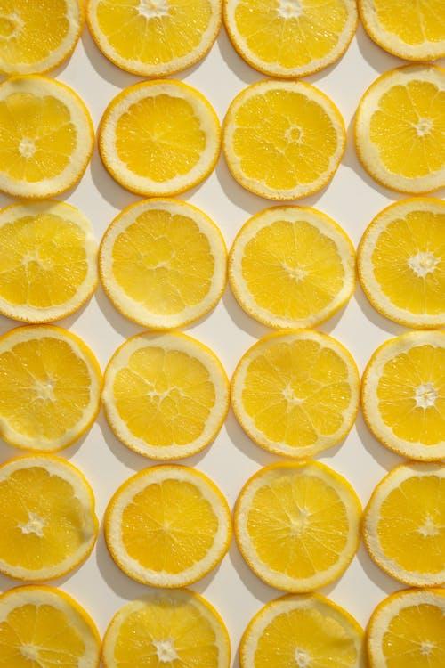 Sliced citrus fruits laid on table