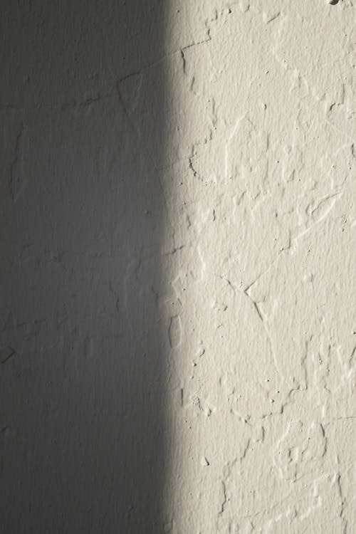 Rough concrete wall of white color