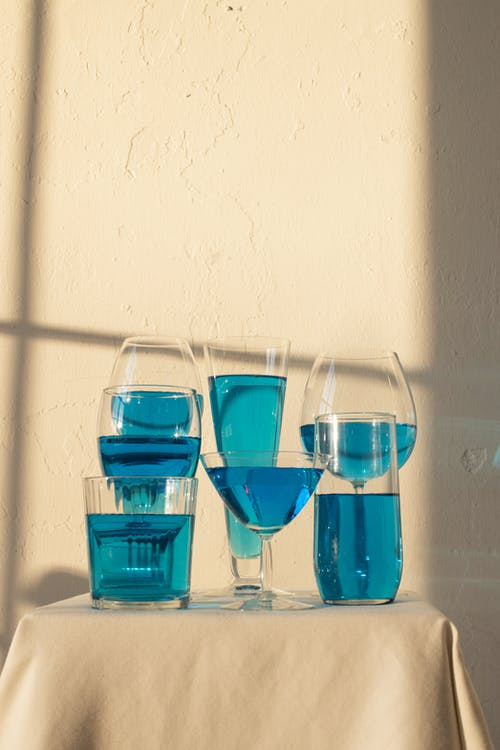 Table served with glassware filled with blue liquid