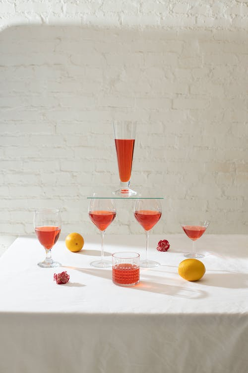 Glasses and oranges arranged on table