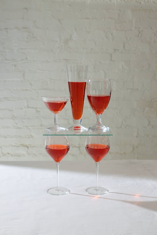 Composition of glasses with red drink