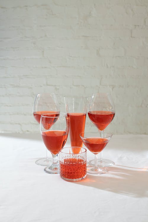 Set of glasses with red drink