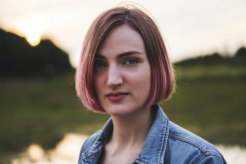 Woman Wearing Blue Denim Jacket Selective Focus Photograph