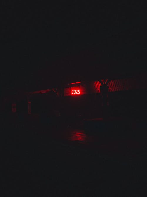 Red and White Train on Rail during Nighttime