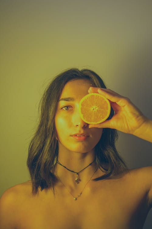 Woman Holding Sliced Lemon Fruit