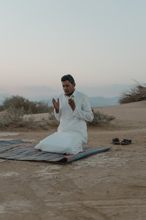 Photo Of Man Kneeling On A Mat