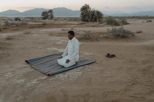 Photo Of Man Kneeling On Mat