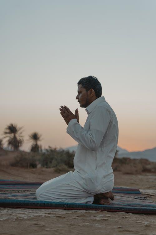 Photo Of Man Praying During Dawn